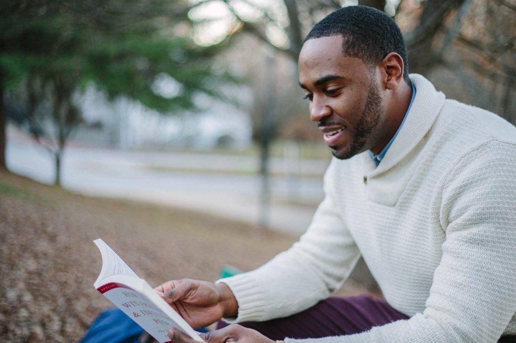 Image of Black man enjoying a book